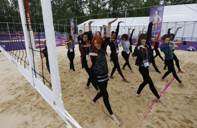 Dancers rehearse at the London 2012 Olympics beach volleyball venue in central London July 19, 2012. REUTERS/Suzanne Plunkett (BRITAIN - Tags: SPORT OLYMPICS SOCIETY VOLLEYBALL ENTERTAINMENT)