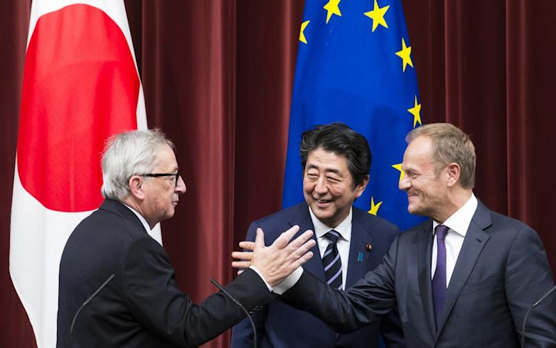 Shinzo Abe, Japan's prime minister, with Jean-Claude Juncker (left) and Donald Tusk. - Bloomberg