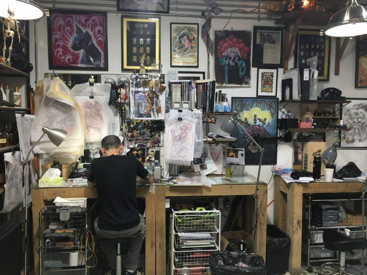 A tattoo artist at Johnny Two Thumbs Tattoo Studio, located at Far East Plaza. (Yahoo Lifestyle Singapore)