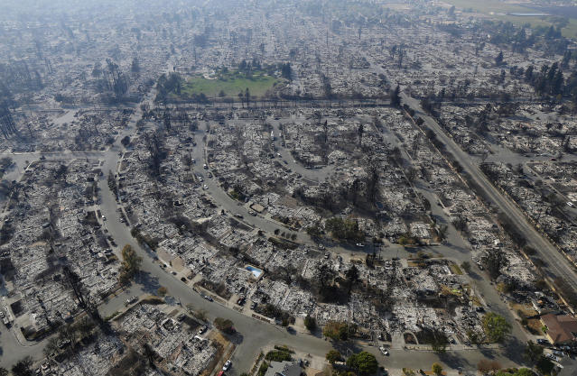 <p>Homes burned by a wildfire are seen Wednesday, Oct. 11, 2017, in Santa Rosa, Calif. (Photo: Jeff Chiu/AP) </p>
