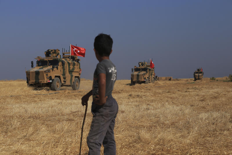 "A Turkish n armored vehicles patrol as they conduct a joint ground patrol with American forces in the so-called ""safe zone"" on the Syrian side of the border with Turkey, near the town of Tal Abyad, northeastern Syria, Friday, Oct.4, 2019. The patrols are part of a deal reached between Turkey and the United States to ease tensions between the allies over the presence of U.S.-backed Syrian Kurdish fighters in the area. (AP Photo/Baderkhan Ahmad)"