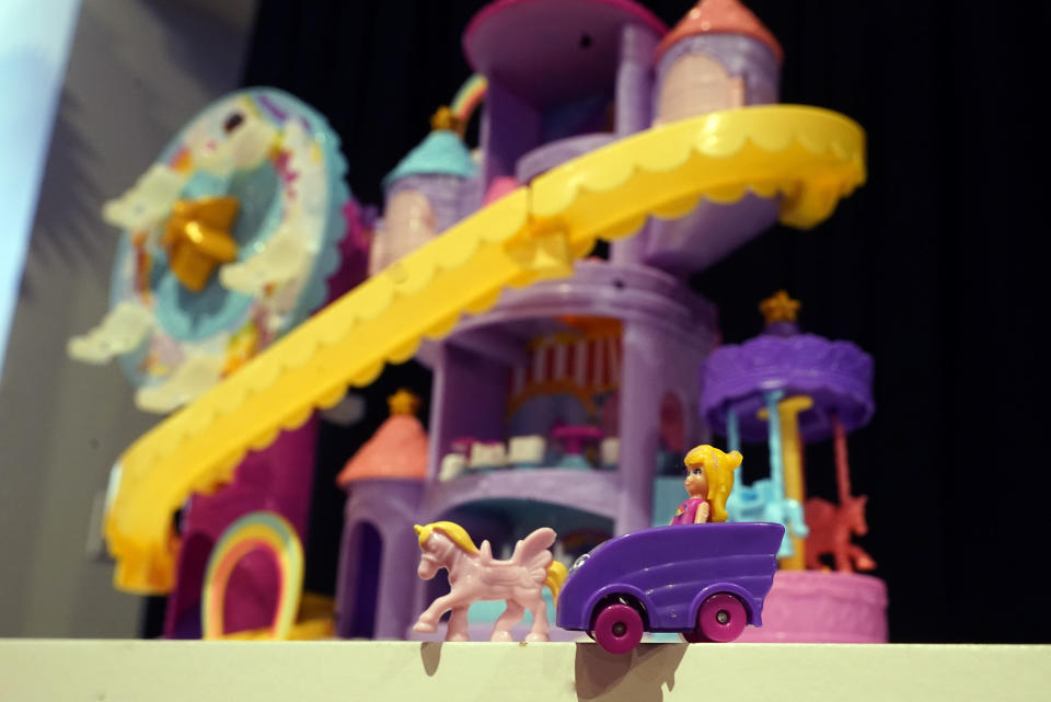 Polly Pocket figures are displayed at the TTPM Holiday Showcase, in New York, Thursday, Sept. 23, 2021. With three months until Christmas, toy companies are racing to get their toys onto store shelves as they face a severe supply network crunch. Toy makers are feverishly trying to find containers to ship their goods while searching for new alternative routes and ports. (AP Photo/Richard Drew)
