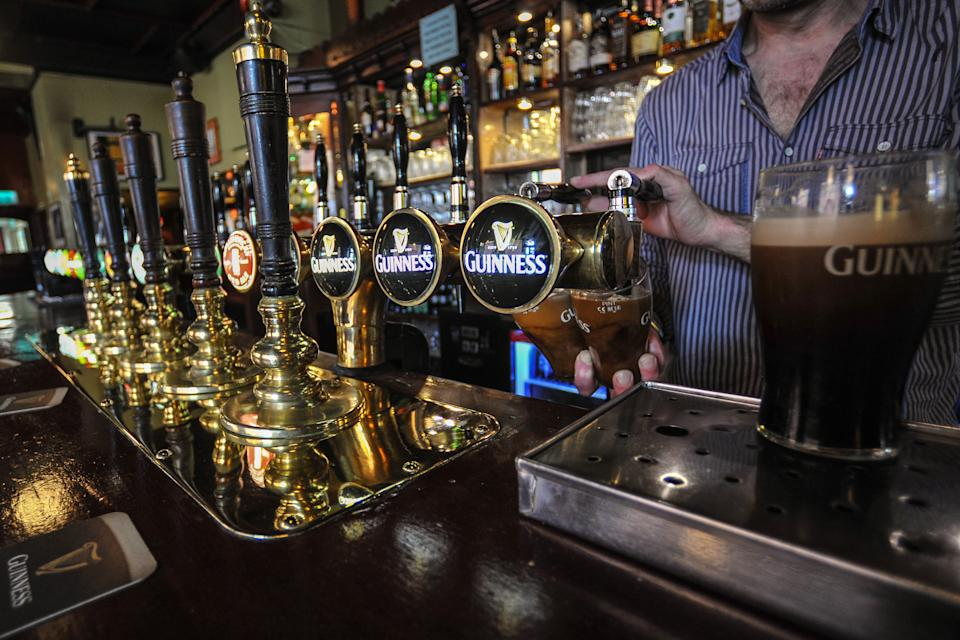 A bartender pulls two pints of Guinness at the bar in MB.SLATTERY�S, a traditional Dublin pub located in the heart of Rathmines that has been in the Slattery family for two generations. On Monday, April 3, 2017, in Rathmines, Dublin, Ireland. Photo by Artur Widak *** Please Use Credit from Credit Field ***