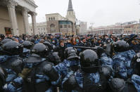 People clash with police during a protest against the jailing of opposition leader Alexei Navalny in Moscow, Russia, Sunday, Jan. 31, 2021. Thousands of people took to the streets Sunday across the country to demand the release of Navalny, keeping up the wave of nationwide protests that have rattled the Kremlin. Hundreds were detained by police. (AP Photo/Alexander Zemlianichenko)