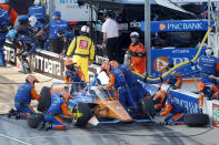 Scott Dixon has a change of tires and adjustments made to his car during a pit stop early during an IndyCar auto race at Texas Motor Speedway in Fort Worth, Texas, Saturday, June 6, 2020. (AP Photo/Tony Gutierrez)