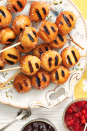 """<p>One way to steal your guests' hearts without breaking the bank? Show off with a menu of out-of-the-box grilled foods, like these skewered doughnut holes! Ree's <a href=""""https://www.thepioneerwoman.com/food-cooking/recipes/a11592/grilled-peaches-pecans/"""" rel=""""nofollow noopener"""" target=""""_blank"""" data-ylk=""""slk:grilled peaches"""" class=""""link rapid-noclick-resp"""">grilled peaches</a> are another great idea.</p><p><strong><a href=""""https://www.thepioneerwoman.com/food-cooking/recipes/a33407727/doughnut-hole-kebabs-recipe/"""" rel=""""nofollow noopener"""" target=""""_blank"""" data-ylk=""""slk:Get the recipe"""" class=""""link rapid-noclick-resp"""">Get the recipe</a>.</strong></p><p><strong><a class=""""link rapid-noclick-resp"""" href=""""https://go.redirectingat.com?id=74968X1596630&url=https%3A%2F%2Fwww.walmart.com%2Fsearch%2F%3Fquery%3Dskewers&sref=https%3A%2F%2Fwww.thepioneerwoman.com%2Fjust-for-fun%2Fg36599700%2Fsummer-party-ideas%2F"""" rel=""""nofollow noopener"""" target=""""_blank"""" data-ylk=""""slk:SHOP SKEWERS"""">SHOP SKEWERS</a><br></strong></p>"""