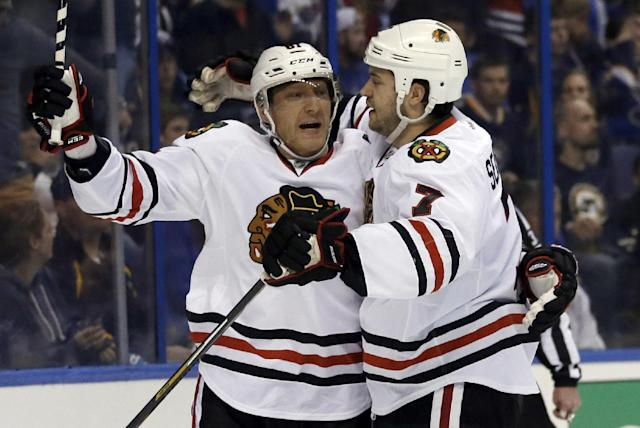 Chicago Blackhawks' Brent Seabrook, right, is congratulated by Marian Hossa, of Slovakia, after scoring during the first period in Game 1 of a first-round NHL hockey Stanley Cup playoff series against the St. Louis Blues on Thursday, April 17, 2014, in St. Louis. (AP Photo/Jeff Roberson)