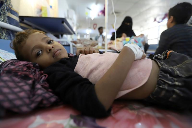 Boy lies on a bed as he recuperates from dengue fever at a hospital in Hodeidah