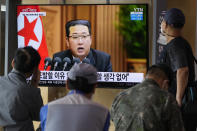 """People watch a TV screen showing North Korean leader Kim Jong Un in a news program, at Seoul Railway Station in Seoul, South Korea, Thursday, Sept. 30, 2021. Kim expressed his willingness to restore stalled communication lines with South Korea to promote peace in early October, while he shrugged off recent U.S. offers for dialogue by calling them """"more cunning ways"""" to conceal its hostility against the North, state media reported Thursday. (AP Photo/Ahn Young-joon)"""