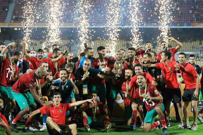 Morocco celebrate becoming the first country to win successive editions of the African Nations Championship.