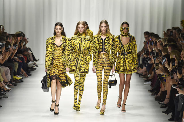 Models from the Versace SS18 show. Creative director Donatella Versace used many archival prints that her late brother, Gianni Versace, created in honor of the 20th anniversary of his death. (Photo: Catwalking/Getty Images)