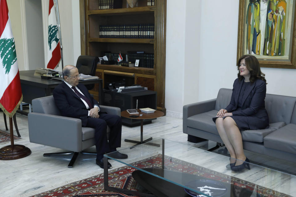 In this photo released on Thursday, June 11, 2020 by the Lebanese Government, President Michel Aoun, left, meets with U.S. Ambassador to Lebanon Dorothy Shea, at the Presidential Palace in Baabda, east of Beirut, Lebanon. A Lebanese court issued a ruling Saturday barring local and foreign media in the country from interviewing the U.S. ambassador to Beirut for a year, calling a recent interview in which she criticized the powerful Hezbollah group seditious and a threat to social peace. (Dalati Nohra/Lebanese Government via AP)