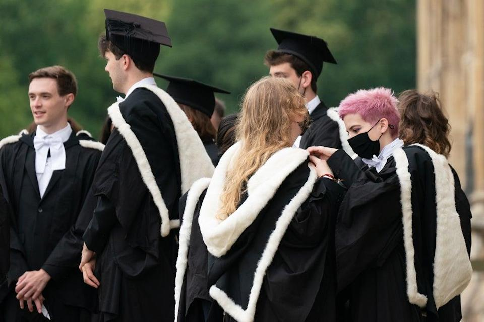 Universities in England can charge up to £9,250 per year for an undergraduate degree (PA) (PA Wire)