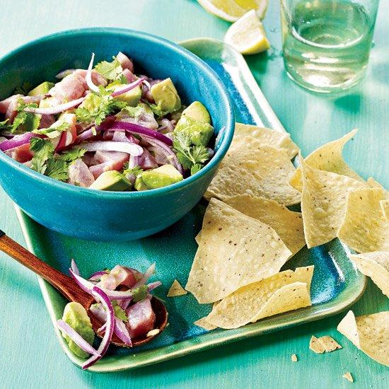 "<p>With only a few ingredients, Rick Bayless's <em>salpimentado</em> (salt-and-pepper) ceviche is typical of what one would find at stands around the southern tip of Baja. Cooks often make it with <em>sierra</em>, a large and meaty Mexican fish, but tuna works just as well.</p><p><a href=""https://www.foodandwine.com/recipes/tuna-ceviche-with-avocado-and-cilantro"">GO TO RECIPE</a></p>"