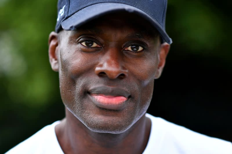 FILE PHOTO: Patrick Hutchinson, a black protester who carried a white man to safety during clashes, poses for a portrait in London