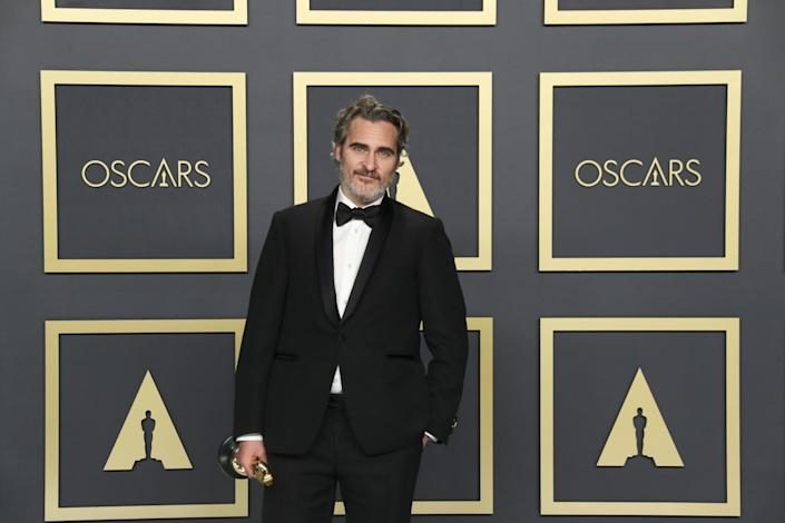 Joaquin Phoenix holds his Oscar at the 92nd Academy Awards