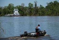 Chandler Bell, 51, heads out fishing on the Tombigbee River, which flows past two chemical plants in Alabama