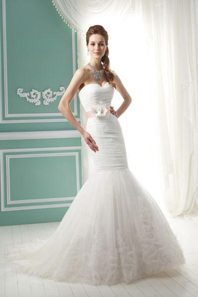 """<div class=""""caption-credit""""> Photo by: Jasmine Collection</div><div class=""""caption-title"""">10. Jasmine Collection</div>For a sweet approach, consider this Swiss dot mermaid by Jasmine Collection. This darling gown is perfect for a country house wedding. <br> <br> Check out more gorgeous styles in our <a rel=""""nofollow noopener"""" href=""""http://www.bridalguide.com/photo-galleries/bridal-gowns/jasmine-collection/style-f141052"""" target=""""_blank"""" data-ylk=""""slk:Jasmine Collection gown gallery"""" class=""""link rapid-noclick-resp"""">Jasmine Collection gown gallery</a>!"""