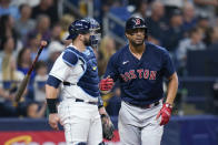 Boston Red Sox's Xander Bogaerts (2) tosses his bat after hitting a solo home run, next to Tampa Bay Rays catcher Mike Zunino during the third inning of Game 2 of a baseball American League Division Series, Friday, Oct. 8, 2021, in St. Petersburg, Fla. (AP Photo/Chris O'Meara)