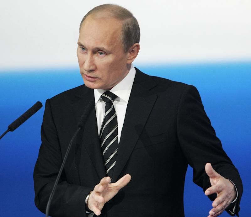"""Russian Prime Minister Vladimir Putin speaks at the United Russia party congress in Volgograd, about 900 kilometers (550 miles) southeast of Moscow, Russia, Friday, May 6, 2011. Putin has proposed creating a """"broad popular front"""" ahead of Russia's parliamentary election in an apparent attempt to counter growing public discontent with his political party. (AP Photo/RIA Novosti, Alexei Nikolsky, Pool)"""