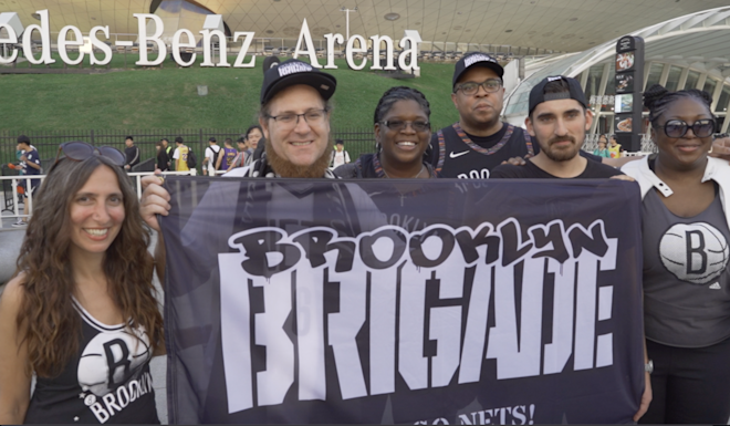 "Members of the Brooklyn Brigade fan club outside the stadium in Shanghai. They say they ""love China and love basketball"". Photo: Patrick Blennerhassett"