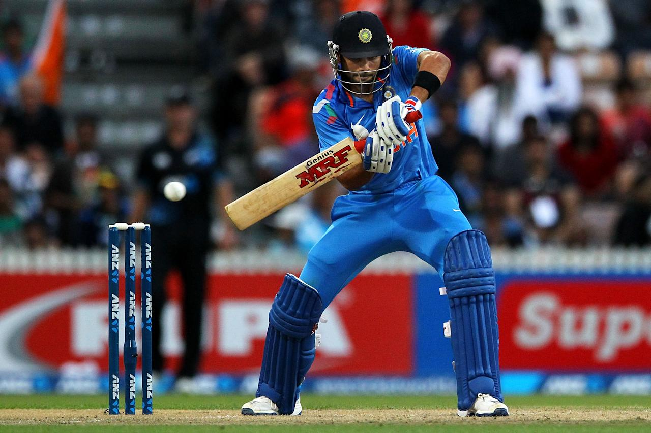 HAMILTON, NEW ZEALAND - JANUARY 22: Virat Kohli of India bats during the One Day International match between New Zealand and India at Seddon Park on January 22, 2014 in Hamilton, New Zealand.  (Photo by Anthony Au-Yeung/Getty Images)