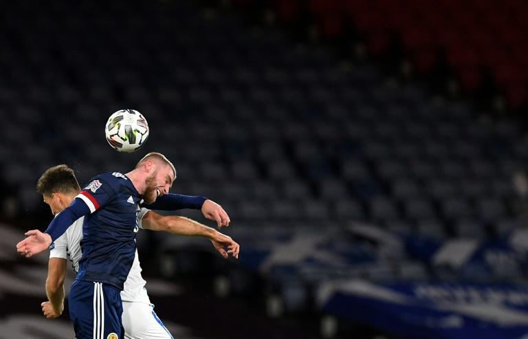 Scotland's Oli McBurnie (R) is still waiting to score his first international goal