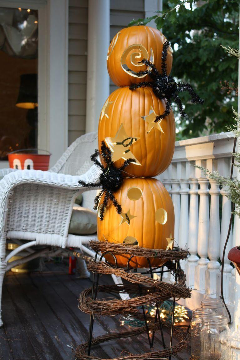 """<p>Calling all overachievers: Take things to the next level—literally!—with this pumpkin topiary idea. </p><p><strong>Get the tutorial at <a href=""""http://oursouthernnest.blogspot.com/2010/09/pumpkin-topiary-turtorial.html"""" rel=""""nofollow noopener"""" target=""""_blank"""" data-ylk=""""slk:Our Southern Nest"""" class=""""link rapid-noclick-resp"""">Our Southern Nest</a>.</strong></p><p><strong><a class=""""link rapid-noclick-resp"""" href=""""https://go.redirectingat.com?id=74968X1596630&url=https%3A%2F%2Fwww.walmart.com%2Fsearch%2F%3Fquery%3Dfaux%2Bspiders&sref=https%3A%2F%2Fwww.thepioneerwoman.com%2Fhome-lifestyle%2Fcrafts-diy%2Fg36982763%2Fpumpkin-carving-ideas%2F"""" rel=""""nofollow noopener"""" target=""""_blank"""" data-ylk=""""slk:SHOP FAUX SPIDERS"""">SHOP FAUX SPIDERS</a><br></strong></p>"""