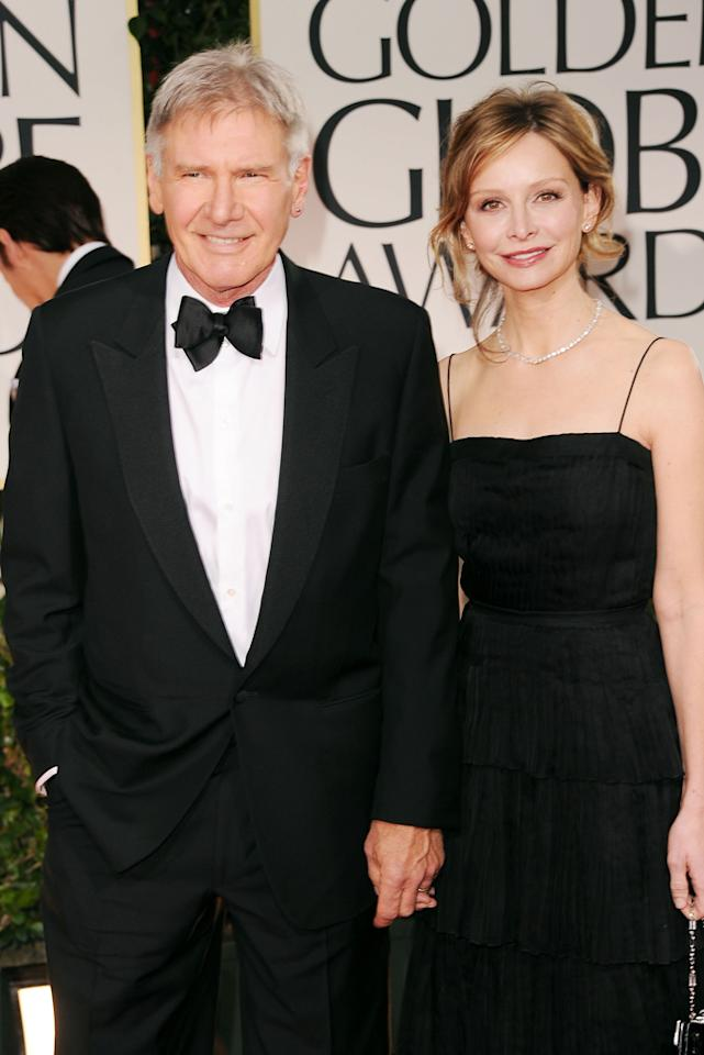 Harrison Ford (L) and Calista Flockhart arrive at the 69th Annual Golden Globe Awards in Beverly Hills, California, on January 15.