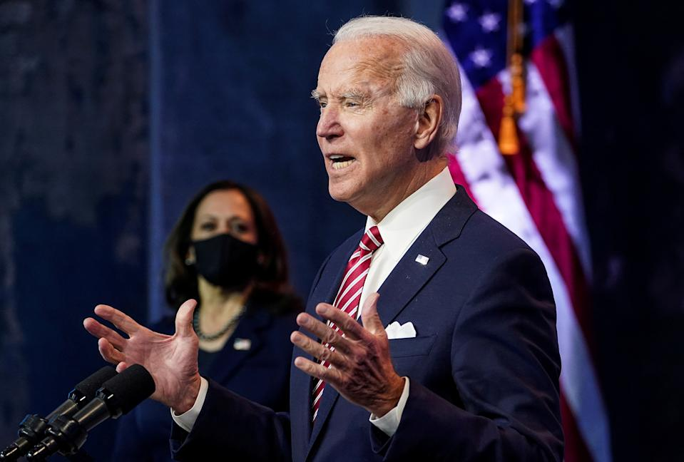 President-elect Joe Biden speaks as Vice President-elect Kamala Harris stands by in Wilmington, Del., on Nov. 16, 2020. (REUTERS/Kevin Lamarque/File Photo)