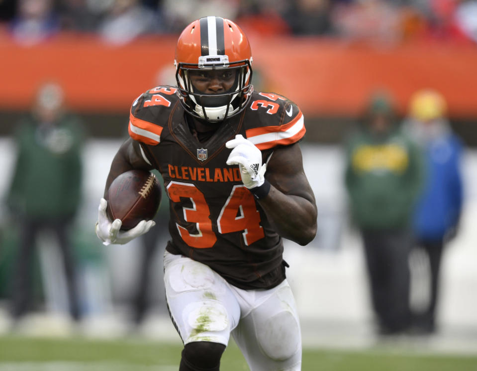 FILE - In this Dec. 10, 2017, file photo, Cleveland Browns running back Isaiah Crowell carries the ball during an NFL football game against the Green Bay Packers in Cleveland. The New York Jets have filled two holes on their roster by signing Crowell and kicker Cairo Santos. (AP Photo/David Richard, File)