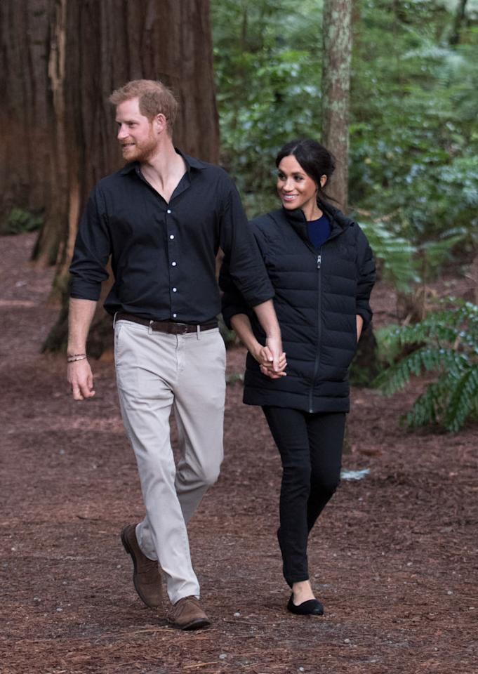 <p>For the royal couple's last day on the tour, Prince Harry lent his wife, Meghan, his Norrona black puffer jacket to keep warm. Markle wore it over her navy Givenchy top from earlier in the day and paired it with her Mother Denim black skinny jeans and Birdies black flats. (Photo by Pool/Samir Hussein/WireImage) </p>