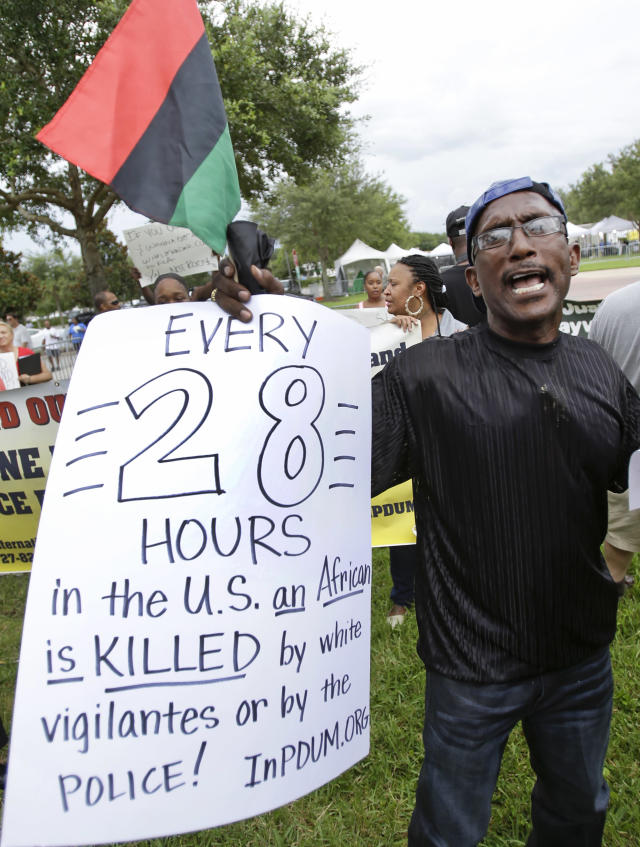 Curtis Sykes, of St. Petersburg, Fla., demonstrates in front of the Seminole County Courthouse while the jury deliberates in the trial of George Zimmerman, Friday, July 12, 2013, in Sanford, Fla. Zimmerman has been charged in the 2012 shooting death of Trayvon Martin. (AP Photo/John Raoux)