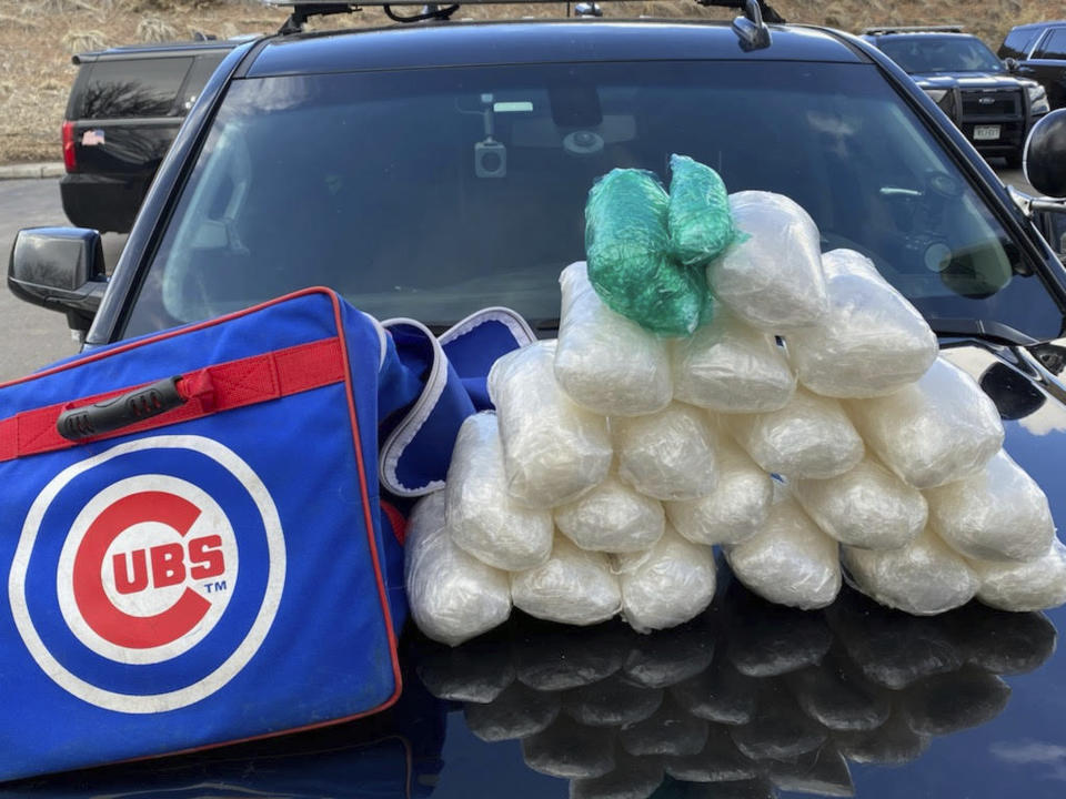 This Wednesday, March 17, 2021 photo released by the Eagle County Sheriff's Office shows methamphetamine and oxycodone pills found inside a duffel bag of Chicago Cubs minor league baseball player Jesus Camargo-Corrales, 25, in Vail, Colo. The Vail Daily reports Camargo-Corrales appeared in Eagle County Court on Thursday, March 18, 2021 on charges including unlawful distribution of methamphetamine and oxycodone, both class 1 drug felonies, as well as charges of unlawful possession of each drug, both class 4 drug felonies. The Eagle County jail confirmed he was still in custody as of Saturday, March 20. (Eagle County Sheriff's Office via AP)