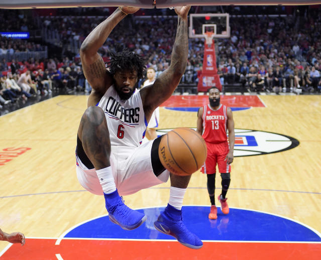 "<a class=""link rapid-noclick-resp"" href=""/ncaaf/players/255448/"" data-ylk=""slk:DeAndre Jordan"">DeAndre Jordan</a> throws down what the Clippers were know for. (AP)"