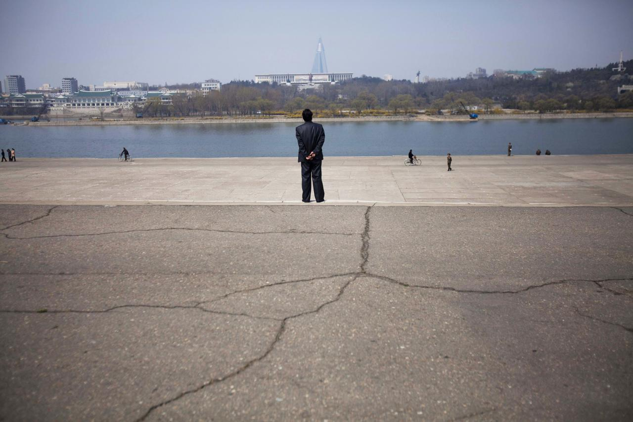 In this April 13, 2011 photo, people stroll along the Taedong River in Pyongyang, North Korea. (AP Photo/David Guttenfelder)