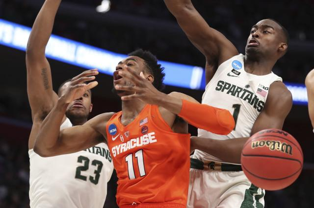 Syracuse forward Oshae Brissett (11) loses control of the ball as Michigan State forward Xavier Tillman (23) and guard Joshua Langford (1) defend during the first half of a second-round game in the NCAA college basketball tournament Sunday, March 18, 2018, in Detroit. (AP Photo/Carlos Osorio)