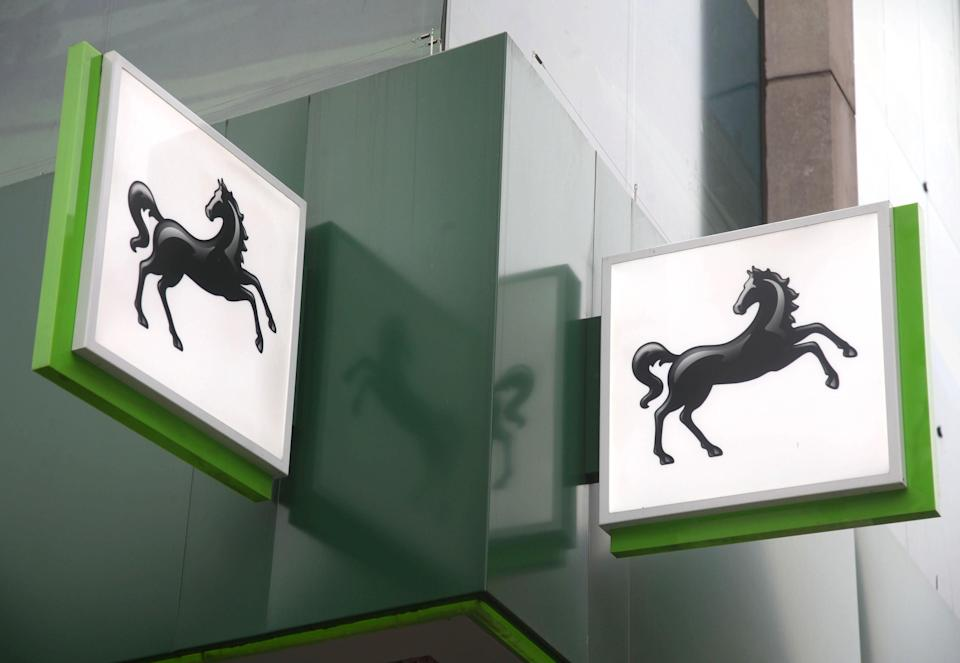 Lloyds Banking Group has revealed it swung to a £3.9bn half-year profit from a £602m loss a year ago as it cut bad debt provisions thanks to the UK's economic recovery (Yui Mok/PA) (PA Archive)