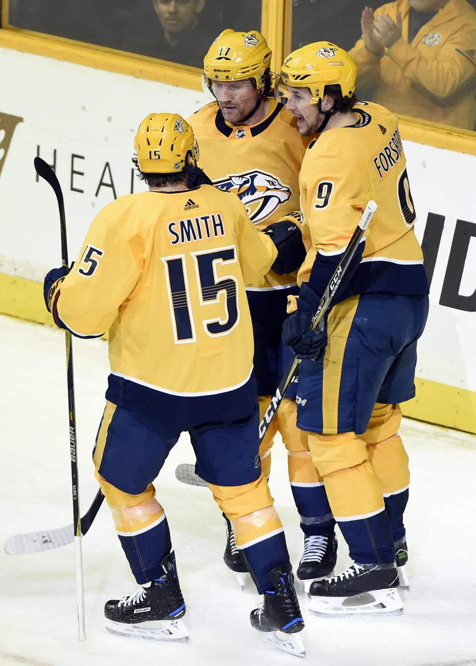 Nashville Predators left wing Filip Forsberg (9), of Sweden, celebrates with Craig Smith (15) and Scott Hartnell (17) after scoring a goal against the Columbus Blue Jackets during the first period of an NHL hockey game Saturday, April 7, 2018, in Nashville, Tenn. (AP Photo/Mark Zaleski)