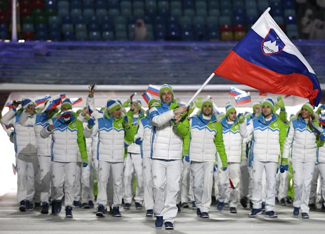 Tomaz Razingar of Slovenia carries the national flag as he leads the team during the opening ceremony of the 2014 Winter Olympics in Sochi, Russia, Friday, Feb. 7, 2014. (AP Photo/Mark Humphrey)