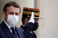 FILE PHOTO: French President Macron welcomes OECD, EU, Spain leaders at Elysee Palace in Paris