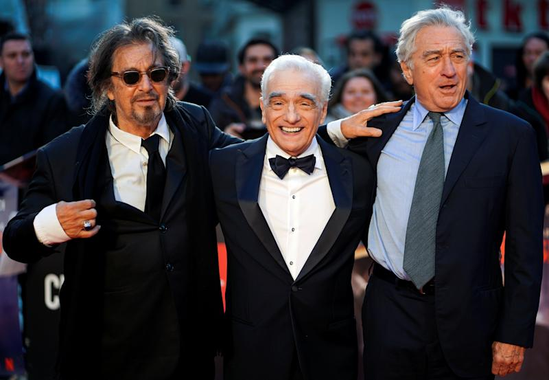 "Director Martin Scorsese and cast members Al Pacino and Robert De Niro pose as they arrive for the screening of ""The Irishman"" during the 2019 BFI London Film Festival at the Odeon Luxe Leicester Square in London, Britain October 13, 2019. REUTERS/Henry Nicholls TPX IMAGES OF THE DAY"