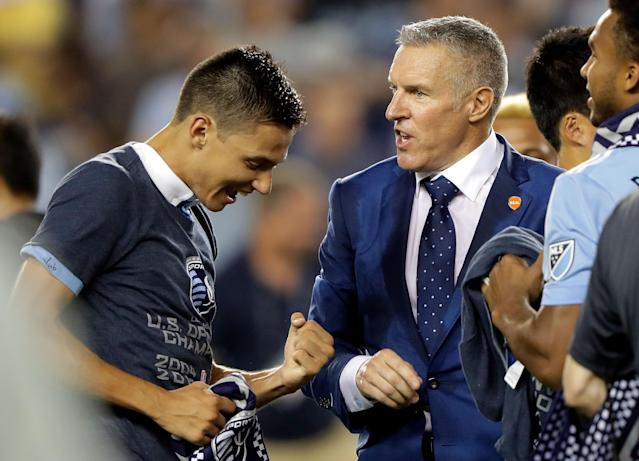 Head coach Peter Vermes congratulates Daniel Salloi after Sporting Kansas City defeated the New York Red Bulls 2-1 to win the 2017 U.S. Open Cup on Sept. 20, 2017 in Kansas City, Kansas. (Jamie Squire/Getty Images)