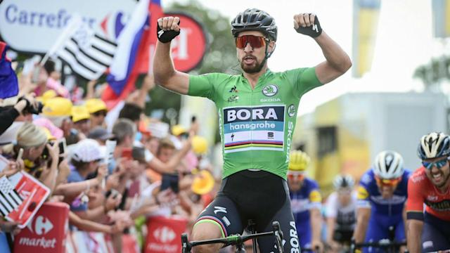 World champion Peter Sagan produced a trademark burst to win stage five of the Tour de France, while Greg Van Avermaet stayed in yellow.