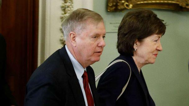 PHOTO: Sen. Lindsey Graham and Sen. Susan Collins arrive for the trial of President Donald Trump at the Capitol, Jan. 21, 2020, in Washington. (Steve Helber/AP)