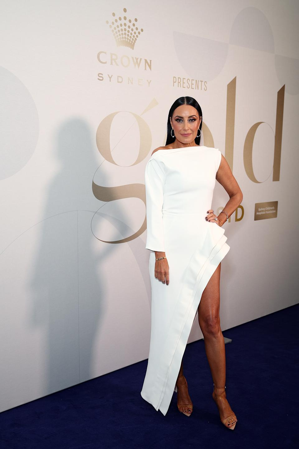 Terri Biviano wears a white gown with a thigh-high split at the Gold Dinner 2021 on June 10, 2021 in Sydney, Australia
