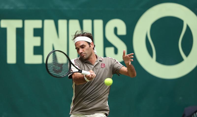 Roger Federer opened his grass court season with a win over Australia's John Millman in Halle on Tuesday