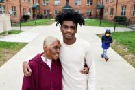 Woody and her grandson Scott stand for a portrait near the home they share in Washington