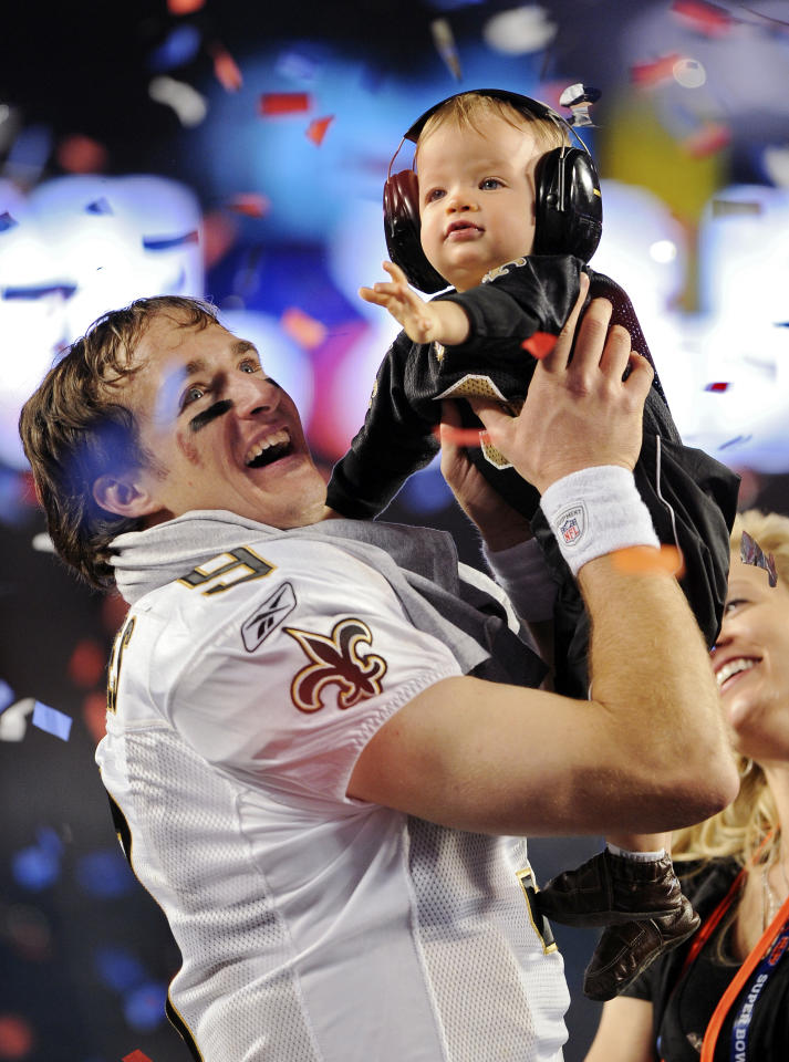 FILE - In this Feb. 7, 2010 file photo, New Orleans Saints quarterback Drew Brees celebrates with his son Baylen and wife Brittany after winning the NFL Super Bowl XLIV football game against the Indianapolis Colts in Miami. This image is one in a portfolio of 12 by AP photographer Mark J. Terrill which won the AP's Thomas V. diLustro award for best portfolio in the annual contest for AP staffers judged by the Associated Press Sports Editors at their winter meeting.