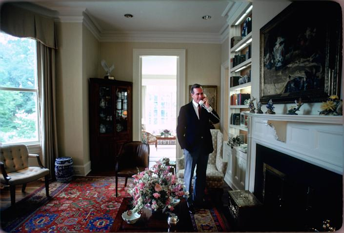 Vice President George H.W. Bush answers a phone call in the residence circa 1983.